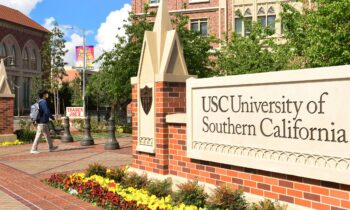 A student wears a facemask at the University of Southern California (USC) in Los Angeles, California on March 11, 2020, where a number of southern California universities, including USC, have suspended in-person classes due to coronavirus concerns. (Photo by Frederic J. BROWN / AFP) (Photo by FREDERIC J. BROWN/AFP via Getty Images)